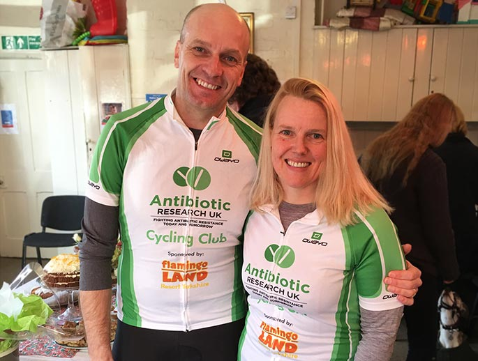 couple taking part in a charity sports event wearing antibiotic research clothing