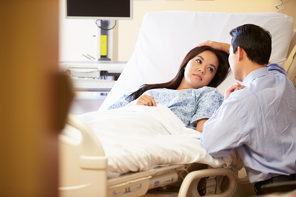 woman in a hospital bed getting treatment for common bacterial infections