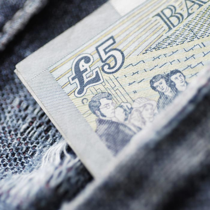 old five pound note in a pocket
