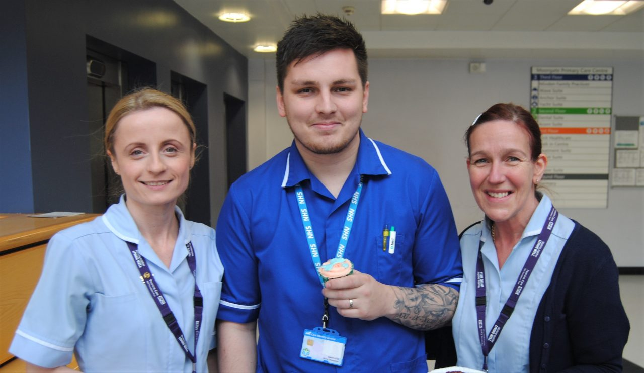 three members of hospital staff