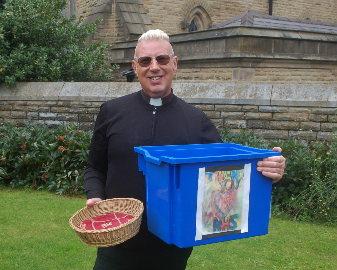 Father John Wiseman taking donations for the NHS